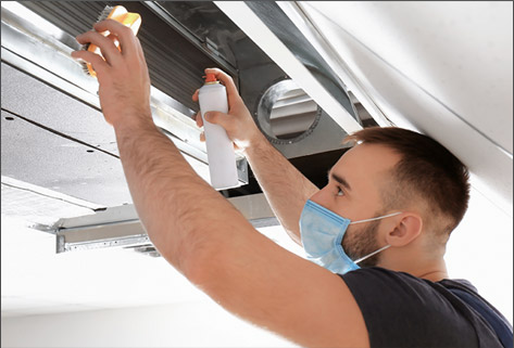 man cleaning aircon