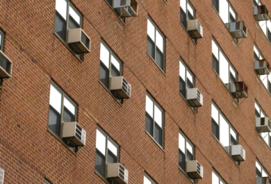 building full of window ac units